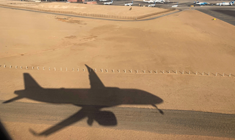 Shadow of an Egyptair airplane landing at Cairo International Airport in Cairo, Egypt March 10, 2020
