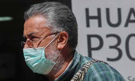 A man, wearing a protective mask due to the spread of coronavirus disease (COVID-19) March 31, 2020.
