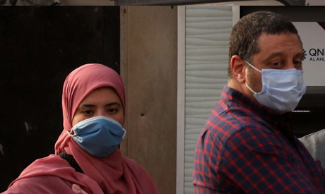 People are pictured wearing protective face masks, amid concerns over the coronavirus disease (COVID