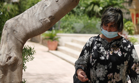 A woman is pictured wearing a protective face mask, amid concerns over the coronavirus disease (COVI