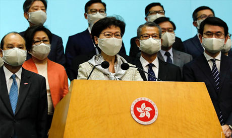 FILE PHOTO: Hong Kong Chief Executive Carrie Lam, wearing a face mask following the coronavirus dise