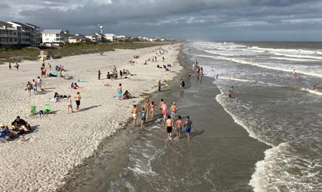People walk on Folly Beach, South Carolina, near Charleston, on May 17, 2020. (AFP)