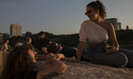 A group of friends enjoy the sunset on the walls of Fort Saint-Jean in Marseille, southern France, T