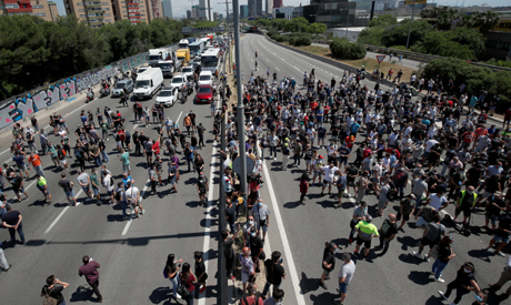Nissan workers block a highway as they protest against the possible closure of the plant at Zona Fra