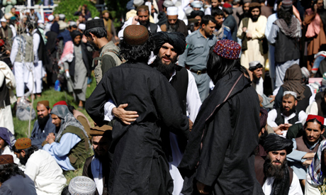 Newly freed Taliban prisoners greet each other at Pul-i-Charkhi prison, in Kabul, Afghanistan May 26