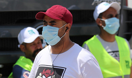 Men wearing protective face masks are pictured in downtown Cairo, amidst concerns about the spread o
