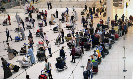 Egyptian citizens queue at Kuwait International Airport before boarding a repatriation flight to Cai
