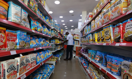 A man wears a protective mask as he shops for groceries at Bakan Gizo supermarket, amid the coronavi