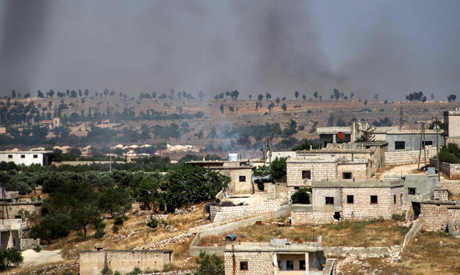 This picture taken on June 4, 2020 shows smoke plumes rising following shelling by pro-Syrian govern