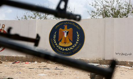 File photo: The emblem of the STC is seen between weapons held by Yemeni government soldiers at the