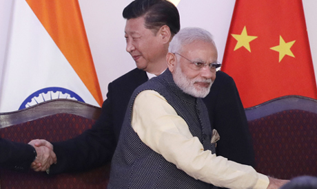 Indian Prime Minister Narendra Modi, front and Chinese President Xi Jinping shake hands with leaders