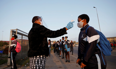 FILE PHOTO: A learner is screened as schools begin to reopen after the coronavirus disease (COVID-19