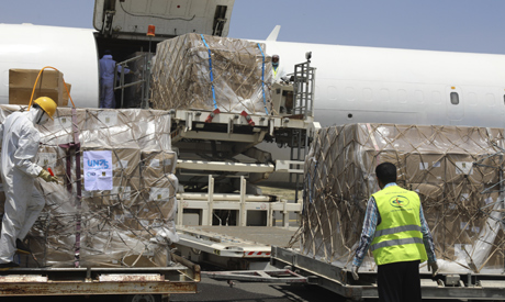 n this Wednesday, June 17, 2020, workers unload boxes of medical supplies on arrival at Sanaa Intern