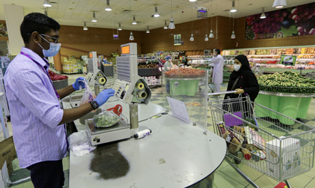 A Saudi woman wearing a face mask, shops at a supermarket following the outbreak of the coronavirus