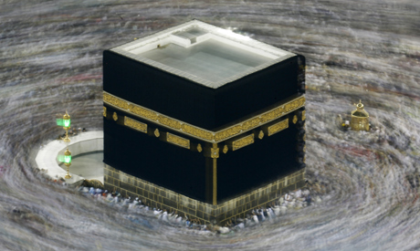 file photo taken with slow shutter speed, Muslim pilgrims circumambulate the Kaaba, the cubic buildi