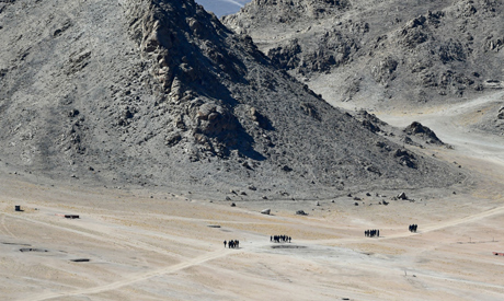 Indian soldiers walk at the foothills of a mountain range near Leh on June 23, 2020. (AFP)
