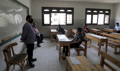 Egyptian high school students attend the first day of final exams