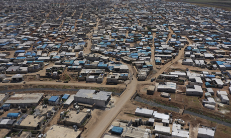 FILE photo shows a large refugee camp on the Syrian side of the border with Turkey, near the town of
