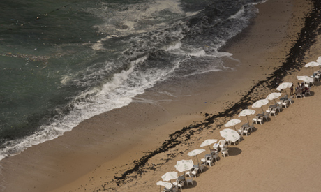 In this Aug. 8, 2019, photo, garbage creeps towards the shore at Stanley Beach in Alexandria, Egypt.