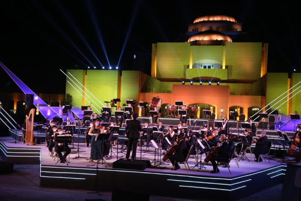 The Cairo Symphony Orchestra performs in the fountain area at the Cairo Opera grounds