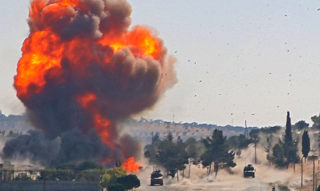 A fireball erupts from the site of an explosion reportedly targeting a joint Turkis-Russian patrol o