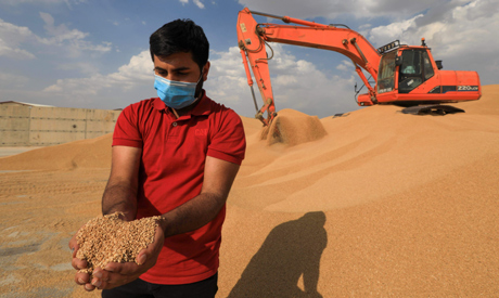 A worker inspects grain at a silo in Arbil, the capital of the northern Iraqi Kurdish autonomous reg
