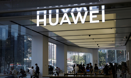 People are seen inside a Huawei store at a shopping mall in Beijing, China July 14, 2020. (Reuters)