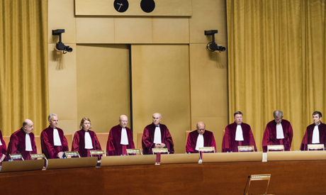 FILE - In this Tuesday, Oct. 6, 2015 file photo, judges preside over a case at the European Court of