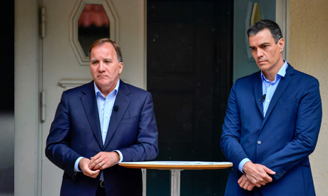 Spanish Prime Minister Pedro Sanchez (R) and Sweden