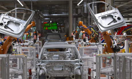 FILE- In this Tuesday, Feb. 25, 2020 file photo, robots work on an electric car ID.3 body at the ass