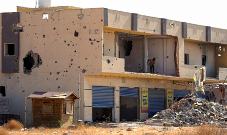 A picture shows a business, damaged during the 14 months of fighting between the UN recognized Gover