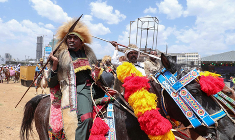 Ethiopian Oromo musician, Haacaaluu Hundeessaa, rides a horse in traditional costume during the 123r