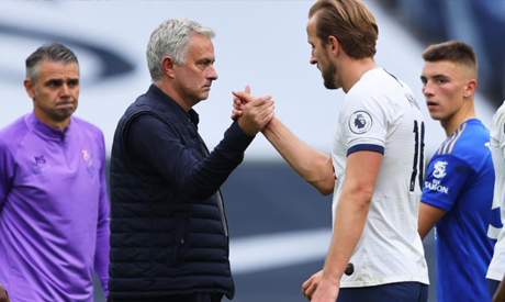 Tottenham Hotspur manager Jose Mourinho celebrates with Harry Kane after the match, as play resumes
