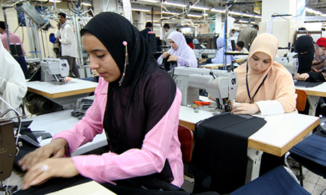 Women work in a factory that makes men