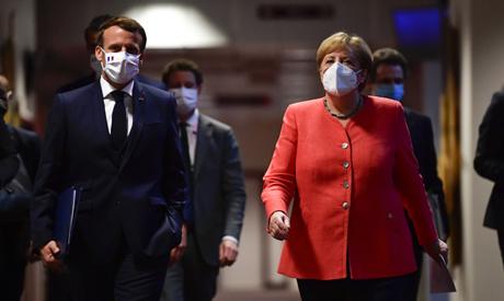 German Chancellor Angela Merkel, center right, and French President Emmanuel Macron, center left, wa