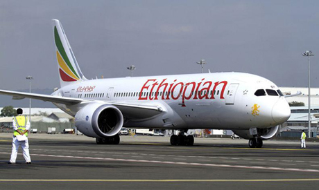 FILE PHOTO: A member of the ground crew directs an Ethiopian Airlines plane at the Bole Internationa