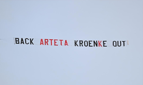 General view as a plane flies over the stadium displaying a banner reading