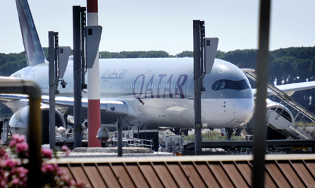 A Qatar Airways aircraft is parked at Rome