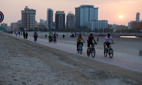 People ride their bikes during the sunset, following the coronavirus disease (COVID-19) outbreak, in