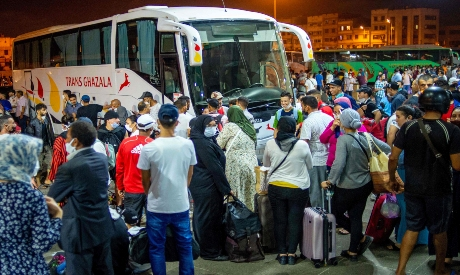 """Moroccans gather in the """"Ouled Ziane"""" bus station in Casablanca"""