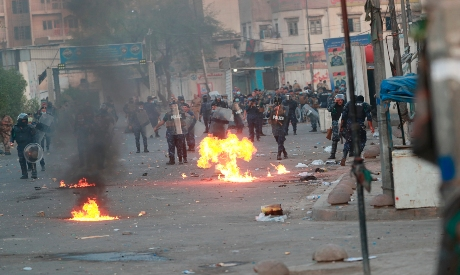 Iraqi security forces try to disperse demonstrators in Baghdad