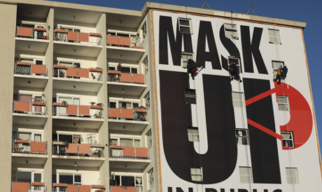 File photo: A billboard is installed on an apartment building encouraging people to wear face masks