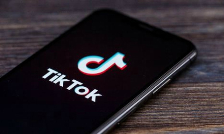 A TikTok logo is displayed on a smartphone (Photo: Reuters)