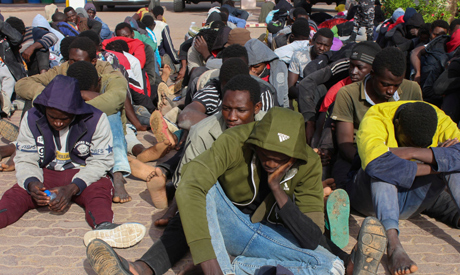 FILE PHOTO: Migrants are seen after being intercepted by Libya
