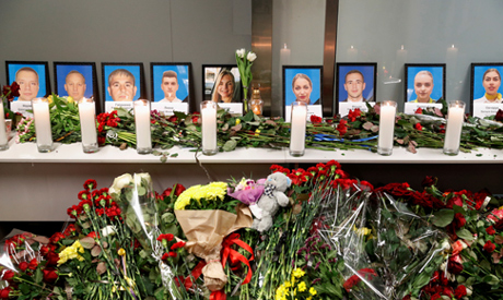 FILE PHOTO: Flowers and candles are placed in front of the portraits of the flight crew members of t