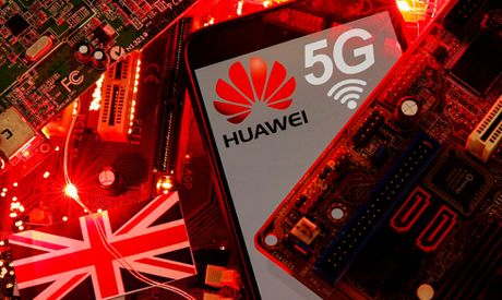 FILE PHOTO: Huawei and 5G network logos are seen on a PC motherboard in this illustration picture ta