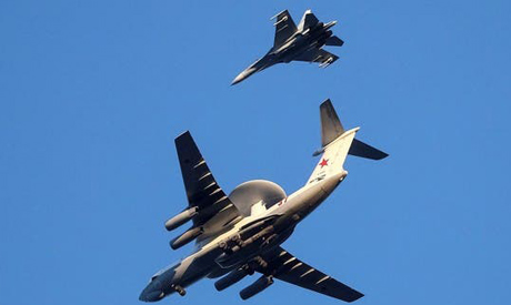 File Photo: Russian Air Force Beriev A-50 early warning aircraft and Sukhoi Su-27 jet fighter fly in