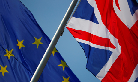 FILE PHOTO: European Union and British flags flutter in front of a chancellery ahead of a visit of B