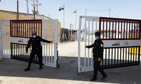 Iraqi Border Guards open the border gate between Iraq and Iran after it partially reopened at the Sh