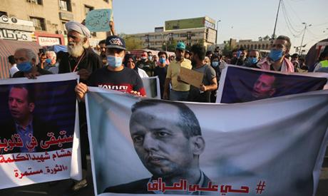 Mourners attend a symbolic funeral for slain Iraqi jihadism expert Hisham al-Hashemi, who was shot d